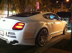 White Bentley Continental GT with custom rims, upholstery, body modifications