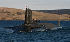 The Trident nuclear submarine HMS Victorious is pictured near Faslane in Scotland.