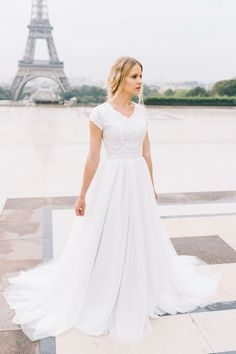 Emerald gown from Saphia Blue by ECD | E & E Photography | | modest wedding dress | modest | wedding gown | lace | ball gown | tulle || Paris | wedding | short sleeves | wedding dress with sleeves |