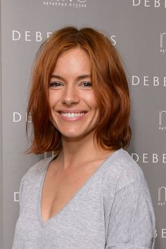 Sienna Miller like you've never seen her before - with rustic red hair