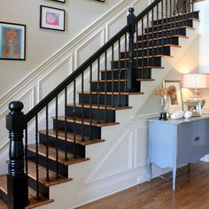 Unusually beautiful black-painted stair risers ... love the look but painting treads black risers white with iron spindles!