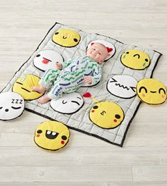 Shop Emoji Baby Activity Mat.  Encouraging endless exploration, our Emoji Baby Activity Mat is perfect for playtime.  The faces have different multisensory features, including a rattle, squeaker and crinkly texture.