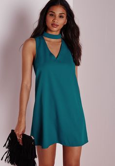Cause a little chaos this season in this teal blue shift dress. With strappy high neck feature and plunging v neckline this dress is totally jaw-to-the-floor knockout. Team this sleeveless number with nude strappy heels and clutch for an on...