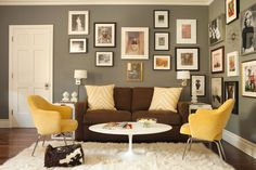 Yellow chairs, brown sofa and grey walls by Karyn R. Millet. (Interior Design by Tim Barber Ltd.)