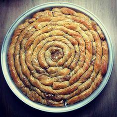 Γλυκιά σιροπιαστή στριφτή Κολοκυθόπιτα με καρύδια. Συνταγή της Δημητρούλας φίλης μου την έφτιαχνε η μαμά της. Είναι από τις αγαπημένες μου πίτες η Κολοκυθόπιτα. Πρώτη φορά δοκίμασα σιροπιαστή και β…