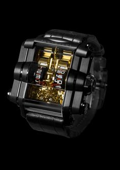 T-1000 Goldorak. The T-1000 Goldorak features SIX mainspring barrels with a world-record 1,000 hour power reserve, generated by an over-sized winding lever integrated into the back of the case, made from natural and blackened titanium. For more information, please visit: http://www.rebellion-timepieces.com/collection-t-1000-time-machine.php#1
