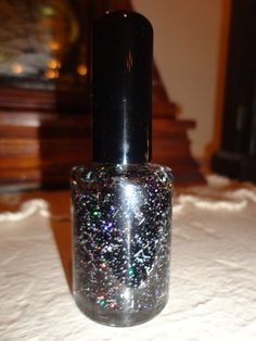 Black Magic nail polish is super glittery and sooo sooo pretty. Mixed with black a touch of silver shredded tinsel. Paris Sparkles nail polish stands alone. If you want to add a clear top coat for maximum shine, no problem but never necessary. Shown with two coats of polish, no top coat.