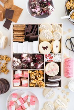 THE ultimate holiday cookie box - with something for everyone. Coconut ice, Honey Caramel Corn, sugar cookie marshmallow sandwiches, marshmallow and sugar cookie rocky road, piped roll out sugar cookies, and a DIY S'mores kit. What more could you wish for - this would be the perfect gift this holiday season.