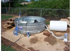 Pics of the stock tank with pool filter set up