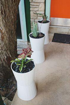 Take two IKEA Kardamumma planters and put them together to make inexpensive tall planters