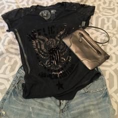 Affliction Tshirt Black and silver Metallic t shirt. Fitted. Flag in the back. Perfect for the fourth! Matches my Coach Clutch listing great! Affliction Tops Tees - Short Sleeve