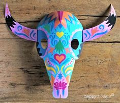 Make this stunning printable Buffalo mask for an easy paper template! Find this and more Mexican Calavera sugar skull mask patterns for Day of the Dead here https://happythought.co.uk/product/printable-calavera-skull-mask-set