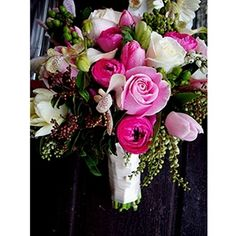 """Pink Garden Bouquet: cream roses, cream tulips, pink and light pink tulips, pink ranunculus, pale pink vanda orchid, anemone, green hypericum, fillers finished with cream satin.              Approx. 8.5"""" diameter"""