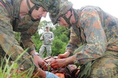 What if you face the squirting, bloody mess of a gaping blackish red hole in someone's shoulder from a blast of AK fire? Army Medic, Combat Medic, German Army, First Aid, Trauma, A Team, Medical, Face, Survival Tips