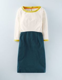 THIS ITEM IS FINAL SALE Blue, White, and a pop of Yellow. This dress is the perfect combination of class and fun. Dress it up or dress it down - you're cute regardless. Features an exposed zipper in t