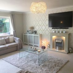 See this Instagram photo by @mrs_rackley.home • lounge living room Chelsea glitter wallpaper next chandelier