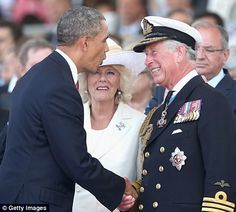 Prince Charles breaks out in laughter as he greets Barack Obama during the international c...