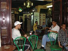 TUNIS CAFE - MEN ARE SMOKING AND DRINKI NG HOT SWEET TEA