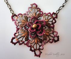 Tatted Necklace Rosy Star by Yarnplayer on Etsy (Used hand dyed Size 10 Lizbeth thread, Delicas beads, and a copper filigree) #tatting #jewelry pendant