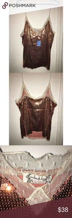 NWT Free People Sequin Tank, size M NWT Free People Sequin tank, size M. Coppery sequins with lace detailing. Brand new, never worn with tags attached. Free People Tops Camisoles