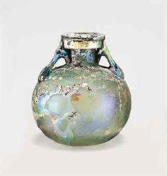 A ROMAN GLASS ARYBALLOS CIRCA 1ST CENTURY A.D. Pale green in color, free-blown,