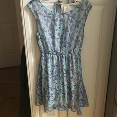 Francesca's Collection Summer Tie Back Dress Worn once. Super cute and light. Tie at neck. Falls above the knee about mid to low thigh. Francesca's Collections Dresses