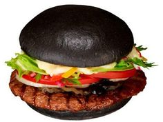 "A black Whopper - made with squid ink and charcoal - from Japan's Burger King.  (It's the limited-edition ""Premium Kuro Burger""...) :)"