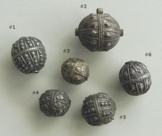 Here is a varied ground of very nice antique silver beads from Yemen.  The decorative elements, some done with hammering and others with soldered additions are always interesting and very specific to the region.   #
