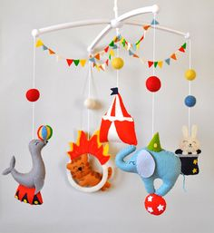 Baby mobile Circus Animals cot mobile Elephant mobile Boy Girl Nursery decor Circus baby shower gift Crib hanging mobile 100% wool felt  Welcome to «minimez»♥   This lovely baby crib felt mobile with circus theme is perfect for a baby boy or girl nursery. Hand-sewn with attention to details from the 100% merino wool felt of highest quality. Each plush element is filled with hypo-allergenic polyester stuffing. All mobiles ship nicely packed and ready to be gifted .  Please see my other baby…