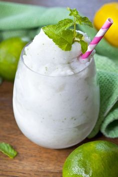 """Frozen Coconut Mojito drink recipe, or """"Cocojito"""", is laced with coconut and has the traditional lime and mint flavors we all love in a good Mojito!"""