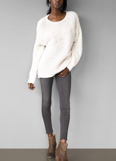 Pair a cozy neutral sweater with grey denim and booties for an effortless fall look.