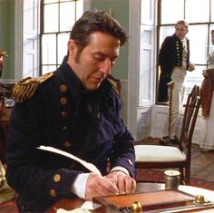 Ciaran Hinds as Captain Wentworth, writing that famous letter to Anne Elliot in Persuasion and confessing his love