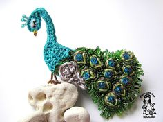 Crocheted and beaded peacock brooch