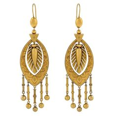 Antique Etruscan Revival Gold Earrings | From a unique collection of vintage dangle earrings at https://www.1stdibs.com/jewelry/earrings/dangle-earrings/
