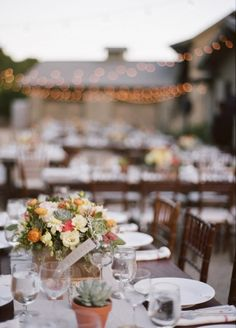 outdoor seating, with succulent floral arrangements, photo by Raya Carlisle Photography
