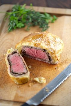Juicy individual beef wellington sliced on a cutting board | jessicagavin.com #recipe