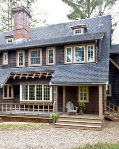 dark siding, white windows, beige trim, grey roof - stone foundation
