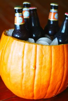 Pumpkin ale on ice served inside of a pumpkin; cool idea for a Fall Harvest time party ;-) with some of my Leinie's in it, maybe? Lol