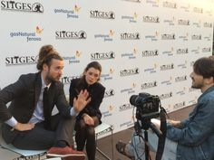 "Actress Àstrid Bergès-Frisbey and director Mike Cahill being interviewed while attending the Sitges Film Festival to promote their film ""I Origins"" (2014)"