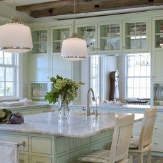 Rejuvenation's Hollywood pendants sparkle in this crisp + clean farmhouse kitchen design by Donald Lococo Architects.