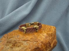 10mm Brown Egyptian Flat Leather Bracelet with Antique Brass Dolpin Slider and Fold Over Clasp