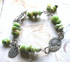 Spring Greens is a unique handmade artisan bracelet. I have used rare chunky chip Variscite beads, which are a beautiful range of creamy spring greens, all hand wrapped with oxidised sterling silver wire. I have joined these beaded sections with handmade sterling silver links and the