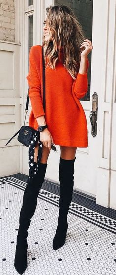Red sweater dress with black OTK boots.