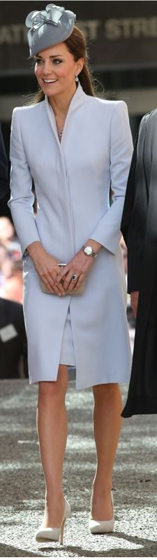 Hat – Jane Taylor  Coat and purse – Alexander McQueen  Necklace – Mappin & Webb  Watch – Cartier  Shoes – LK Bennett
