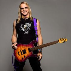 Steve Morse - Best guitar Player....ever.   Voted Best Overall Guitarist 5 years straight and thus retired to Guitar Player Magazine's Hall of Fame (with only two other guitarists....Steve Howe and Eric Johnson).