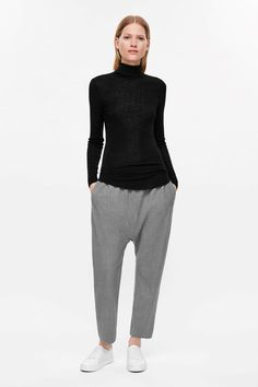 COS image 1 of Roll-neck wool top in Black