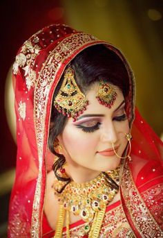 Sweet Bangladeshi bride in red wedding saree.