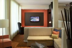 Unwind after a long flight in the Theater Lounge at the Courtyard Orlando Airport.