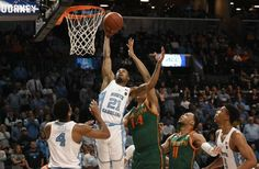 UNC guard Seventh Woods (21) goes up for a rebound over Miami center Rodney Miller (14) in the first half of play during the ACC Men's Basketball Tournament at the Barclays Center in Brooklyn, N.Y., on Thursday, March 9, 2017.