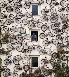 120 bikes on the wall of a bike shop in Berlin, Germany by minerva